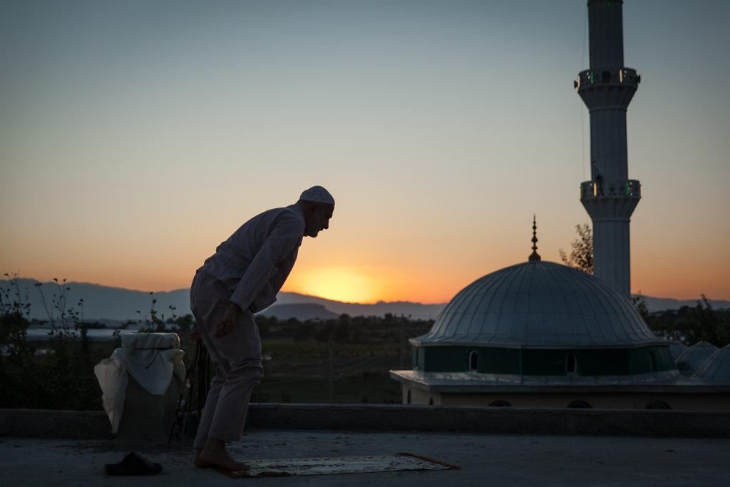 A man kneeling down to pray